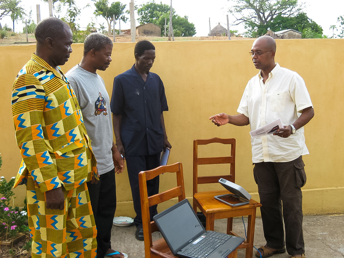 Bible translators in Togo learn about a BGAN, which is used for satellite Internet.