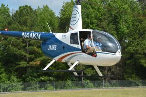 Pilot flying helicopter in US