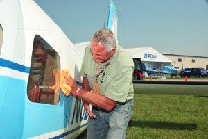 Man cleaning an aircraft